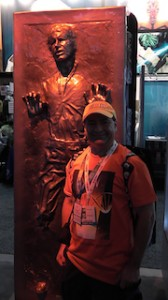 Nick Iandolo stands next to a full-size Han Solo frozen in carbonite.