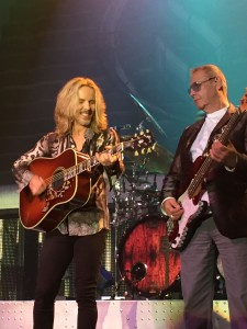 Tommy Shaw (acoustic guitar) with Chuck Panozzo on Bass; Photo Credit: Lori Mars