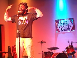 Vatic Kuumba performs as a poet at the Sweet Little Variety Show at Aurora PVD.