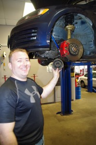 Nick Wadlinger, customer at Gearhead Systems, holds the strut heading into his Volkswagen GTI. (Photo: Michael Bilow)