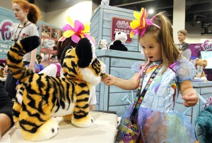 Luca Mammarell plays with the FurReal RoarinÕ Tyler, The Playful Tiger at the FurReal booth at HASCON on Sunday, Sept. 10, 2017.