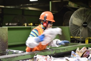 Two photos: Workers manually remove contaminants from conveyor belts of divided materials – at first, picking out stuff that shouldn't have been recycled at all, and then looking for stuff that imperfect machines sent into the wrong lane. In order for the MRF to function, the facility relies on Rhode Islanders to follow the basic rules of recycling. (Credit: Vin Sowders)