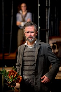Tony Estrella as Uncle Vanya. Background: Marianna Bassham as Yelena (Courtesy: Gamm Theatre; Photo: Peter Goldberg)