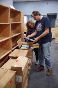 Dawn and Steven Porter unpack inventory as they prepare to open their new bookstore, Stillwater Books in Pawtucket (Photo: Michael Bilow)